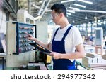 worker pressing buttons on cnc... | Shutterstock . vector #294977342