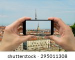 Tourist man taking photo in with smartphone in Torino - stock photo