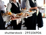 waiters carrying plates with... | Shutterstock . vector #295106906