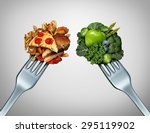 Small photo of Diet struggle and decision concept and nutrition choices dilemma between healthy good fresh fruit and vegetables or cholesterol rich fast food with two dinner forks competing to decide what to eat.