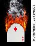Small photo of Playing card with fire and smoke, isolated on white - Ace of diamonds