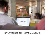 man using laptop in startup... | Shutterstock . vector #295226576