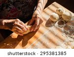 senior woman prepares pies on a ... | Shutterstock . vector #295381385