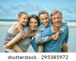 happy family  on the sea beach... | Shutterstock . vector #295385972