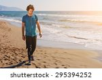Young Male Runner Walking Alon...