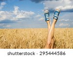 sexy woman legs on blue sky and ... | Shutterstock . vector #295444586