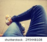 a hipster sitting downtown with ... | Shutterstock . vector #295448108