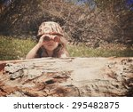 a little girl is hiding behind... | Shutterstock . vector #295482875