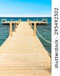 pier over waters  | Shutterstock . vector #295492502