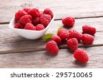 red raspberries in bowl on grey ... | Shutterstock . vector #295710065