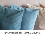 cushions stack on couch | Shutterstock . vector #295725248