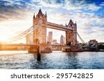 Tower Bridge in London, the UK. Sunset with beautiful clouds. Drawbridge opening. One of English symbols - stock photo