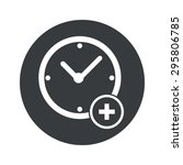 image of clock with plus in...