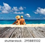couple on a tropical beach at... | Shutterstock . vector #295885532
