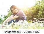 beautiful smiling girl sitting... | Shutterstock . vector #295886132