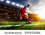 Soccer Players In Action On...