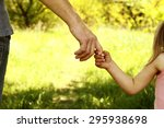 a the parent holding the hand... | Shutterstock . vector #295938698