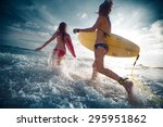 two ladies running into the sea ... | Shutterstock . vector #295951862