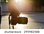 photographer holding a camera... | Shutterstock . vector #295982588