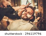 client during beard shaving in... | Shutterstock . vector #296119796