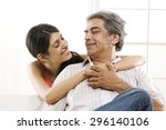 girl with her arms around her... | Shutterstock . vector #296140106
