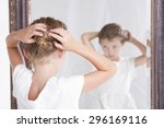 child or young girl fixing her... | Shutterstock . vector #296169116