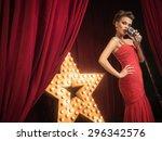 beautiful singer on the scene | Shutterstock . vector #296342576