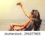 girl doing a selfie at the beach | Shutterstock . vector #296377805