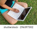 asian girl's hand on laptop... | Shutterstock . vector #296397302