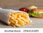 Burger With French Fries On...