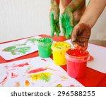 children dipping fingers in... | Shutterstock . vector #296588255