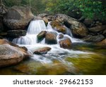 Motion Blur Waterfalls Nature Landscape in Blue Ridge Mountains with green trees, rusty natural orange rocks and flowing water - stock photo