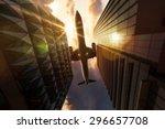 airplane above skyscrapers | Shutterstock . vector #296657708