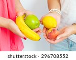 two girls with fruits in the... | Shutterstock . vector #296708552