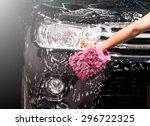 man washing a soapy black car...   Shutterstock . vector #296722325