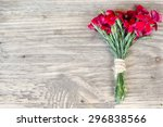 Red Carnation Over Wooden Tabl...