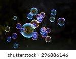 Rainbow Soap Bubbles On A Dark...