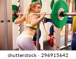 woman weightlifting barbells at ... | Shutterstock . vector #296915642