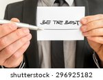 Small photo of Closeup of personal therapist showing a white card with a Be the best sign encouraging you to live up to your fullest potential and realise your goals and dreams.