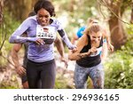 two women enjoying a run in a... | Shutterstock . vector #296936165