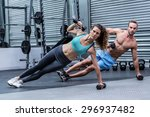 muscular couple doing side... | Shutterstock . vector #296937482