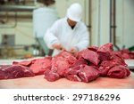 Worker Cuts Meat Butcher...