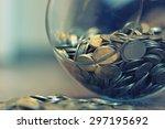 coins in a piggy bank vase | Shutterstock . vector #297195692