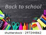 school supplies on blackboard... | Shutterstock . vector #297244862