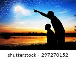 Silhouette Of Father Use Hand...