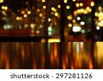 Small photo of blur bokeh reflection light on table in pub or bar club and restaurant Christmas party and celebrate at dark night for display product in brown tone background