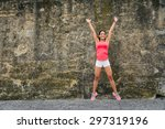 happy female athlete jumping... | Shutterstock . vector #297319196