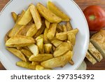 homemade fried potatoes on a... | Shutterstock . vector #297354392