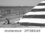 Striped Beach Umbrella And...