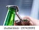 a hand opening a bottle of beer | Shutterstock . vector #297429092